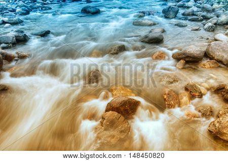 Beautiful Reshi River water flowing through stones and rocks at dawn Sikkim India. Reshi is one of the most famous rivers of Sikkim flowing through the state and serving water to many local people.