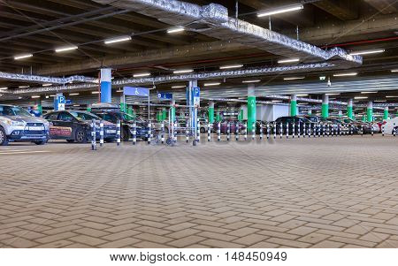 ST. PETERSBURG RUSSIA - JULY 28 2016: Underground car parking Mega shopping mall