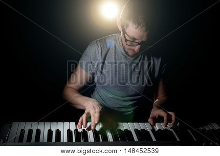 Keyboarder Is Playing And Singing.