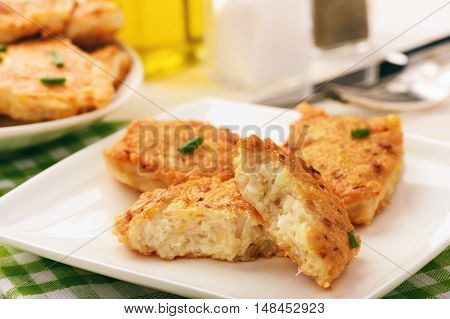 Roasted chicken cutlets with garlic and cheese on white plate.Selective focus.