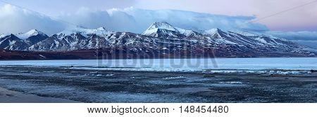 Panorama of Rakshas Tal (Tib. Langa Tso) and Gurla Mandhata Peak in Western Tibet. This lake also known as Demons Lake, Ravana Tal, or Ravan Harda in Hindu Religion