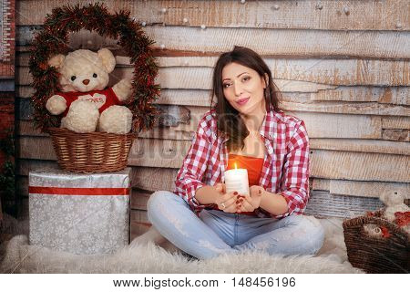 romantic girl holds a candle. The concept of the New Year and Merry Christmas.