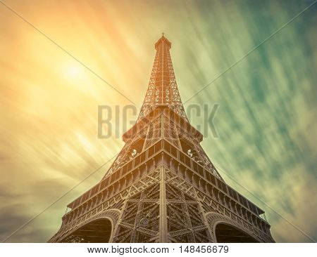 Eiffel Tower under motions clouds. Beautiful view on one of famous popular place in Paris with long exposition.