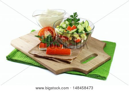 Recipe salad with crab sticks on  white background
