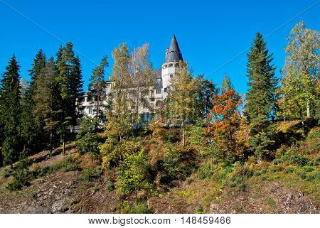 IMATRA, FINLAND - SEPTEMBER 13, 2016: Spa Hotel Rantasipi Imatran Valtionhotelli. Was built in 1903 and designed by the Art Nouveau castle. Canyon of The Imatrankoski Rapids on Vuoksi River