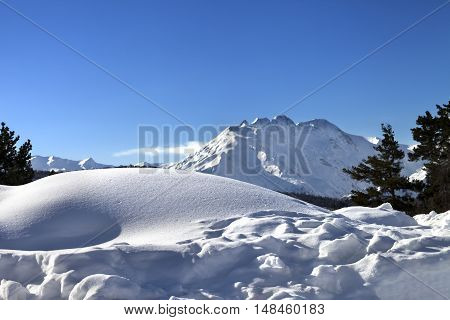 Snowdrifts In Winter Mountain After Snowfall At Sun Day