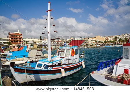 Traditional Greek fishing boat at port of Sitia town at eastern part of Crete island, Greece
