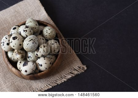 Wooden Bowl With Quail Eggs. Dark Food Photography. Rustic Background, Selective Focus And Diffused