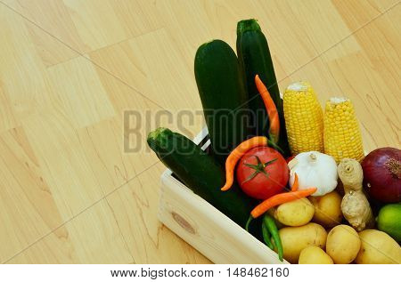 Vegetables in wooden crates on the floor