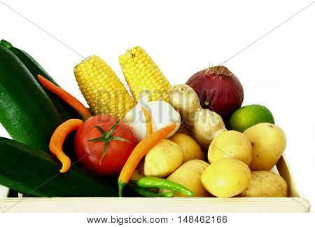 Vegetables in wooden crates with white background