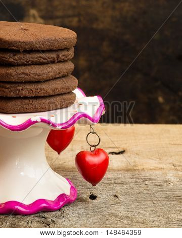 Mexican Hot Chocolate Shortbread Cookies On Antique Stand With Red Hearts