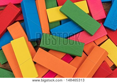 Pile of multicolored wooden blocks abstract on the table