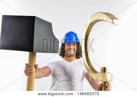 worker in helmet holding a hammer and sickle