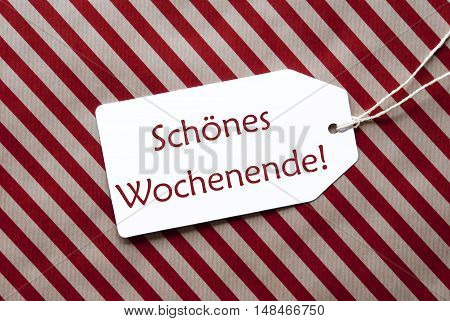 One Label On A Red And Brown Striped Wrapping Paper. Textured Background. Tag With Ribbon. German Text Schoenes Wochenende Means Happy Weekend