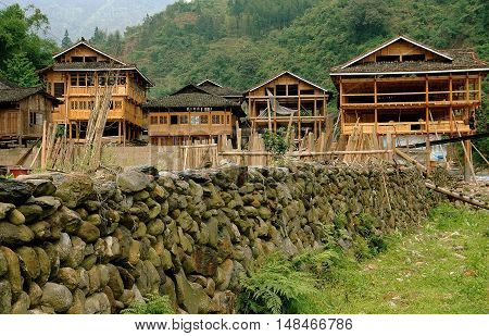 Longsheng China - May 2 2006: Wooden farm houses in the Yao village of Huang Luo in Guang Xi Province