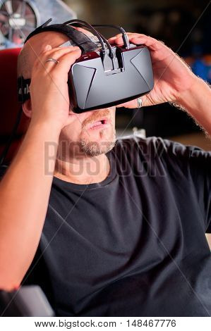 Man play the video game with virtual reality device