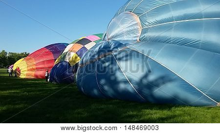 Hot air balloon launch. enthusiasts preparing to go airborne