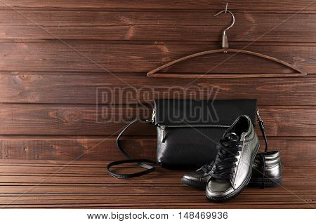 Leather Upper Metallic Trendy Womens Shoes And Black Leather Bag On Brown Wooden Background
