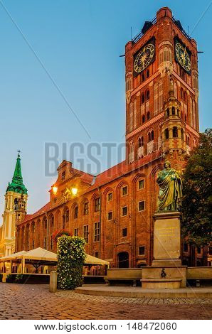Torun, Poland: sunrise in old town city hall, Nicolaus Copernicus monument
