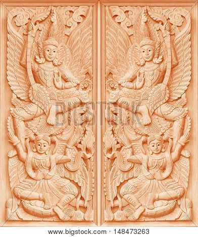 Traditional Old wood carving on the wall of Temple in Thailand Thai style