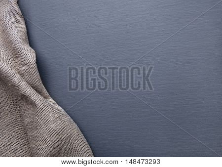 Tablecloth on blue stone board in kitchen texture. For text on the side