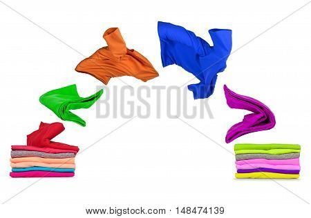 T-shirts fly out of pile and fall on pile isolated on white background