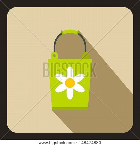 Green bucket with flower icon in flat style on a beige background vector illustration