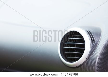 Car interior detail - ventilation system holes closeup