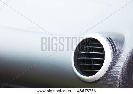 Car interior detail - ventilation system holes closeup
