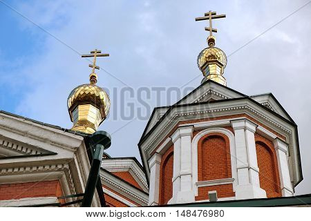 Gilded domes and crosses over church in town Kolomna