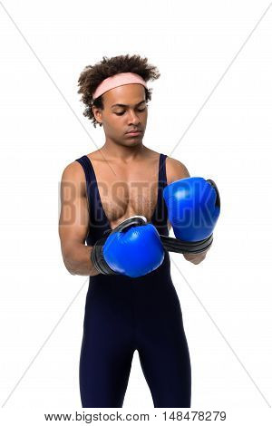 Young handsome sportive african man wearing boxing gloves over white background. Copy space.