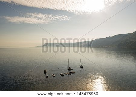 Sea View In Backlight With Moored Boats