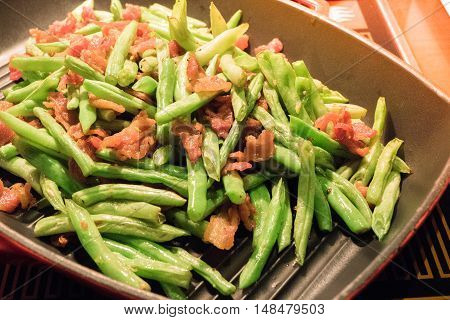 Crispy Bacon With Beans In Frying Pan
