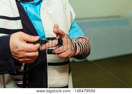 Jewish Man Wrapped In Tefillin Pray