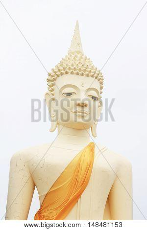 Buddha statue on a white background .