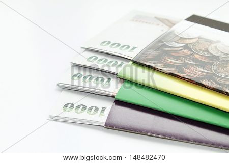 Concept of savings : Money and savings account passbook on white background