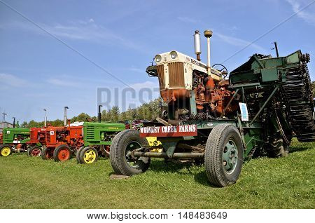 ROLLAG, MINNESOTA, Sept 1. 2016: An old Case 830  tractor rebuilt on a new base pulling a beet picker  and various other tractor models are displayed at the West Central Steam Central Steam Threshers Reunion in Rollag, MN held annually on Labor Day weeken