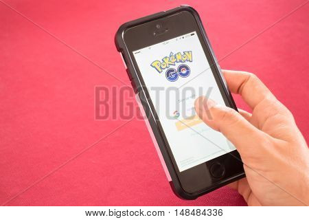 Chiang Rai Thailand - September 13 2016 Apple iPhone5s held on hand showing its screen with Pokemon Go application