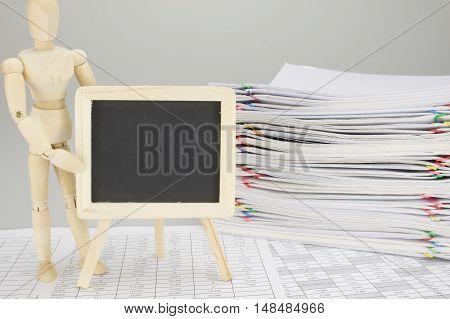 Wooden Dummy Holding Empty Blackboard On Finance Account