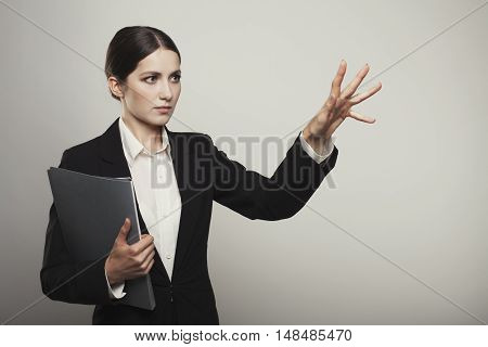successful business woman isolated holding hand photo