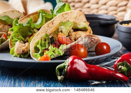 Authentic Mexican Tacos With Chicken And Salsa With Avocado, Tomatoes And Chillies