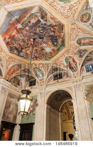 Genoa, Italy - June 26, 2016: Ceiling fresco in palace Palazzo Angelo Giovanni Spinola (Palazzo Doria) at street via Garibaldi. This fresco on the ceiling in the atrium is inteded to honor the buildings patron.