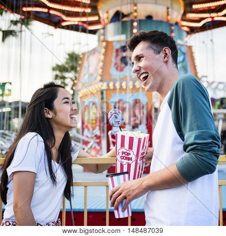 Couple Dating Amusement Park Funfair Festive Playful Happiness Concept