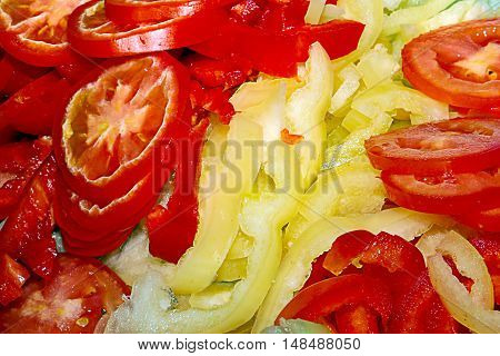 finely chopped pieces of tomatoes and peppers for a vegetable salad