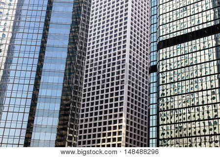Abstract scene of highrise buildings in Hong Kong CBD. Hong Kong is one of the most densly populated areas in the world the vast majority of people work and live in highrise buildings.