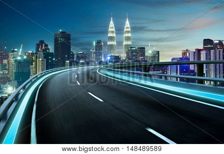 Highway overpass motion blur with city background . night scene .