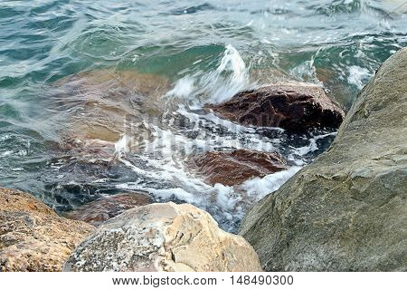 clean clear flowing water and wild rocks