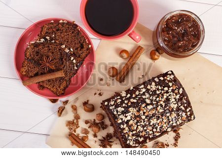 Cup Of Coffee And Dark Cake With Chocolate, Cocoa And Plum Jam, Delicious Dessert