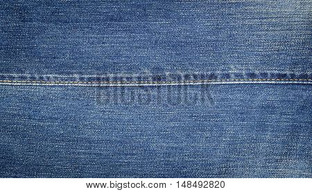 Closeup of denim jeans texture with seams.You can apply for jean background, jean backdrop, jean wallpaper and everything about denim and jean background for you design.