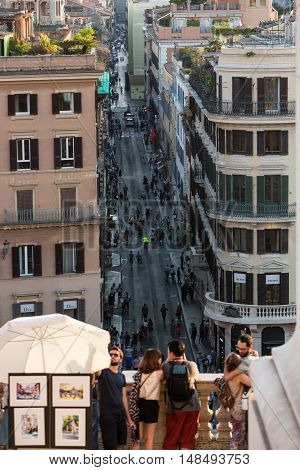 ROME ITALY - JUNE 11 2015: Spanish Steps and Via Condotti in Rome. This street is the center of fashion shopping in Rome with the atelier of Bulgari Armani Cartier Fendi Gucci  and others.
